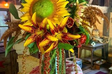 large sunflower and lily arrangement