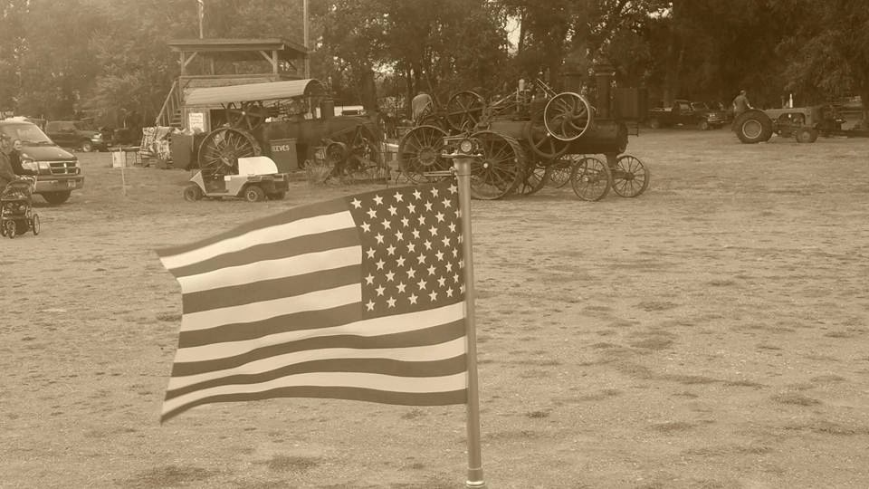American Flag with Antique Steam tractors in the background