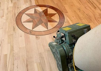 Sanding a hardwood flooring custom medallion with Lagler hummel