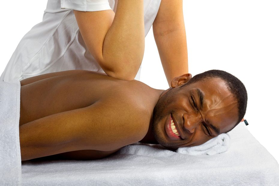 Man getting Deep Tissue Massage in Tacoma. Reasonable prices for the service.