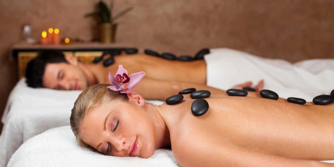Couple receiving a hot stone massage in Fife.