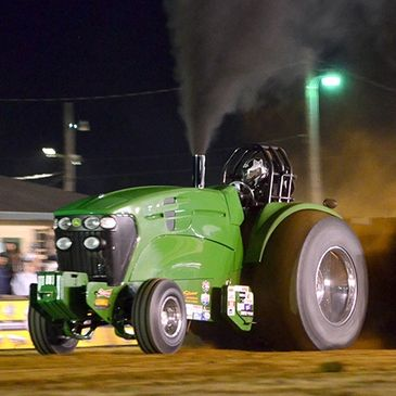 Tractor in mid-pull during the annual Lucas Oil Mega Pull in September.