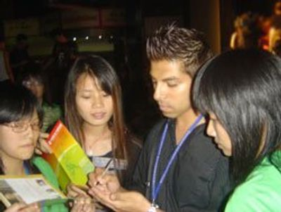 Uriel Saenz takes time to sign autographs for art students after his inspirarional speach in China