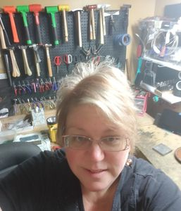 Designs by Dawn copper jewelry line.  View of me in my studio.