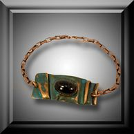 This ammonia copper patina bracelet has a black onyx