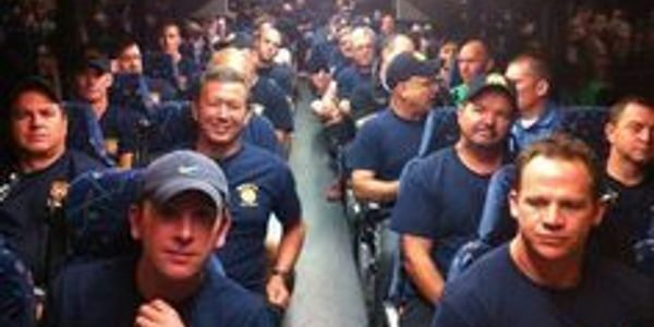Firefighters on the bus home from Houston. Houston had multiple firefighters killed in the line of duty. Dallas firefighters worked in Houston so Houston firefighters could attend funerals.