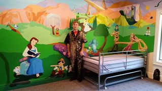 Children's room with characters all over a colorful fantasy land. Cowering walls, doors and ceiling.