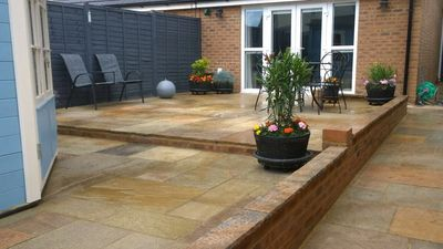 Split level India Sandstone Garden complete wit access slope and walled edging.