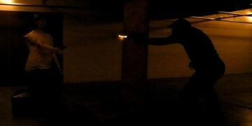 Low light CQB training scenario around cover