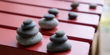 picture of cairns (stacked stones) on red table