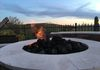 Adding a fire pit as part of your landscaping will extend the enjoyment of your backyard.