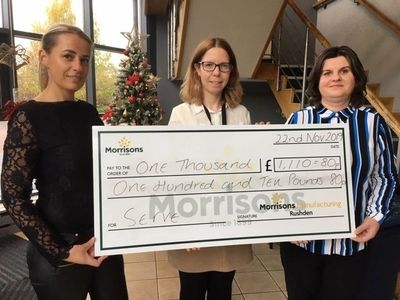 Morrisons supermarket in Rushden presenting large cheque