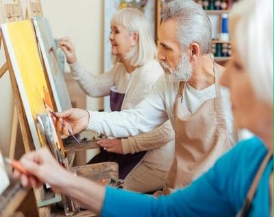 Group of people at day centre painting