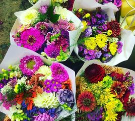 Vibrant fall colors in bouquets made for our Farm Stand!
