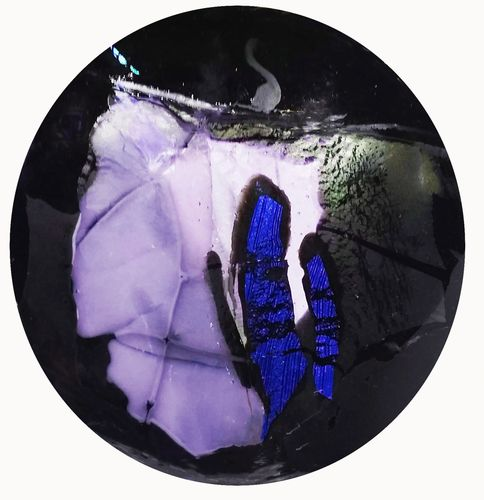 "Variations on black glass fused with  blue dichroic glass create ""The Walls Within Us""."