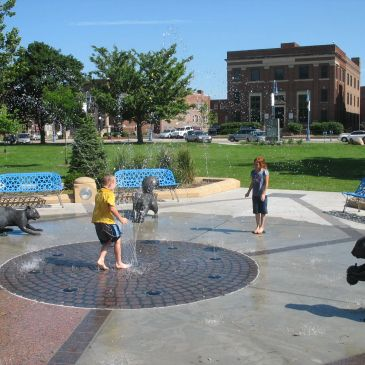The Park has a historic fountain, plaza, splash pad and performance space.