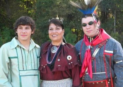 Yonavea Hawkins, artist with her sons wearing their Caddo ribbon shirts.