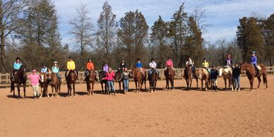 group shot of many participants on their horses used for the camp
