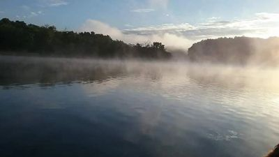 Fog rising over a early morning on the Wisconsin River. Wisconsin Dells, Wisconsin