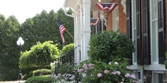 Burnap's Bed & Breakfast and Beyond entrance with flags