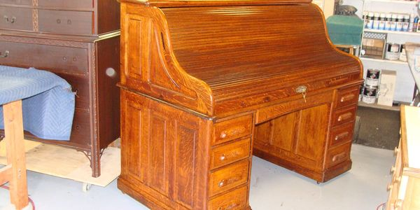 repaired and restored 100 year old Banker's roll top desk