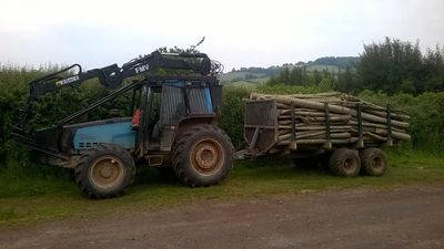 Valtra 6400 forwarding tractor with winch and roof mounted crane. Ideal for small spaces.