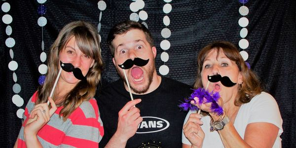Surprise 50th birthday party. DIY photobooth and props.  Photo Credit: Perfectly Planned