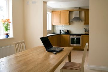 Interior of kitchen with laptop on kitchen table in Jacksonville, Florida