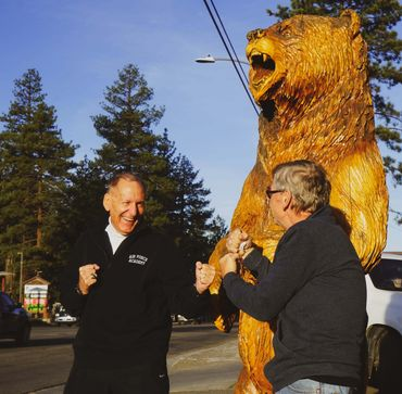 Grizzly Manor Cafe owner Jayme Nordine and local bank president Jack Briner have fun outside