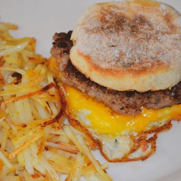 Grizzly Manor Cafe sausage breakfast sandwich and hash browns