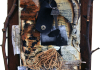 burnt book pages, bark, printed images, key, leather tag, branches, straw
