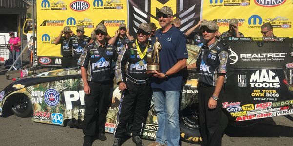 Outdoor Industry Consultant Art Tucker with NHRA Legend John Force after his 2018 win in Denver