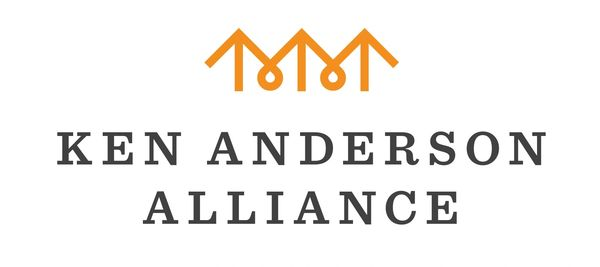 Orange icon resembles upward arrows or rooftops or joining hands, with text Ken Anderson Alliance