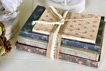 Paper-wrapped book bundle (shown)