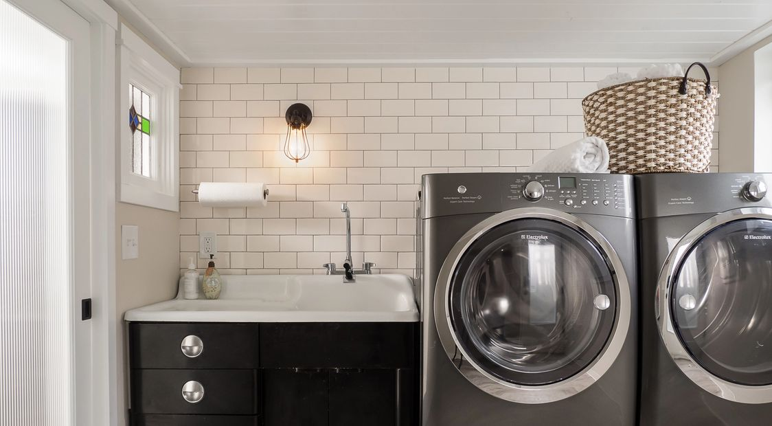 POP remodeled laundry room with vintage sink and subway tile