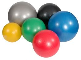 A collection of gym balls in a variety of colours and sizes