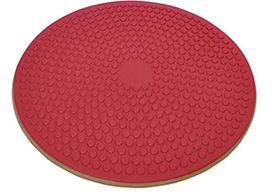 A single wooden wobble board with a red textured rubber grip top
