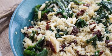Kale and quinoa salad in a blue bowl