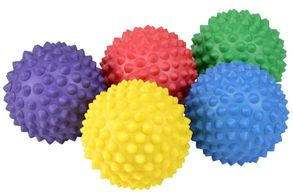 Five spikey massage balls each in different colours