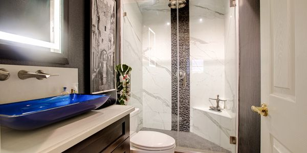 Real Estate Photography of an elegant guest bathroom in Orange, CA