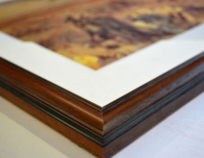 commercially-trained picture framers and reframers