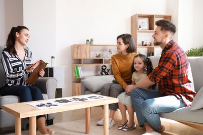 picture of a family in a counseling session.