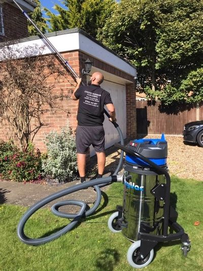 Clearing blocked gutters using a skyvac machine