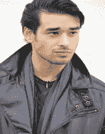 Headshot of John looking pensive. He wears a back leather jacket.