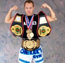 World Champion Fighter Scotty Rae Leffler displays some of his Title Belts