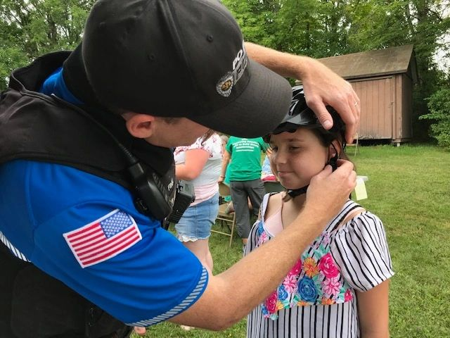 "{""blocks"":[{""key"":""64ob0"",""text"":""We distributed 27 bike helmets at the Back to School Fair! Police Officer Fink helped to fit the helmets and provide bike safety training. More helmets were purchased for families on the waiting list. "",""type"":""unstyled"",""depth"":0,""inlineStyleRanges"":[],""entityRanges"":[],""data"":{}}],""entityMap"":{}}"