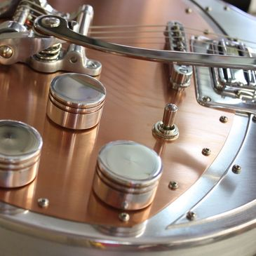 custom electric aluminum and copper guitars