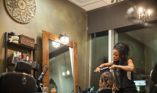 Rayna styling hair at private salon studio Rayna Hair Artistry in West Hollywood Los Angeles