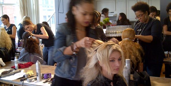 Rayna styling hair backstage during New York Mercedes Fashion Week