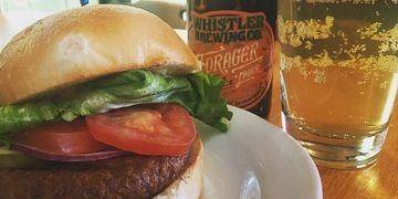 "The ""Beyond Beef"" Vegan Burger Patty and Gluten-Free Bun with a Gluten-Free beer by Whistler Brewing"